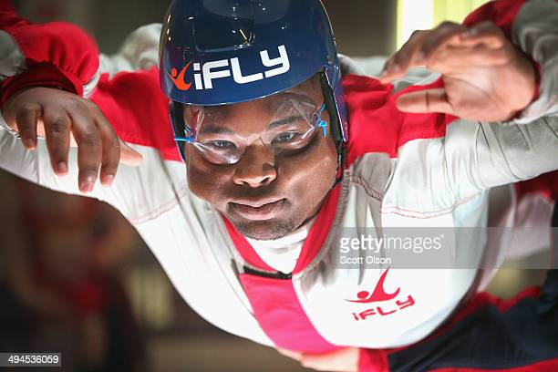 Derrick Garlington learns wind tunnel flying at the iFly indoor skydiving facility on May 29 2014 in Rosemont Illinois Guests at the facility are...