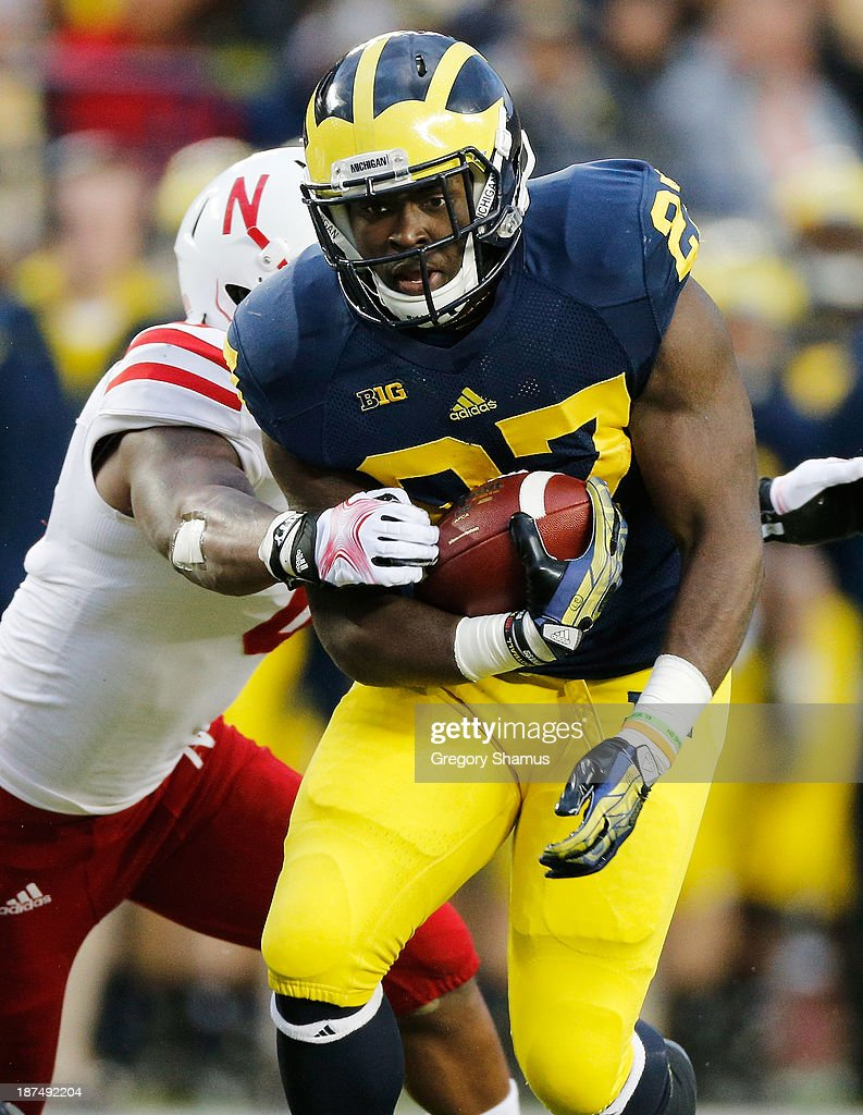 Derrick Green #27 of the Michigan Wolverines breaks a tackle in the second quarter against the Nebraska Cornhuskers at Michigan Stadium on November 9, 2013 in Ann Arbor, Michigan.