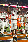 Derrick Henry of the Alabama Crimson Tide celebrates with his teammates after scoring a one yard touchdown in the second quarter against the Clemson...