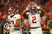 Derrick Henry of the Alabama Crimson Tide celebrates with teammate Kenyan Drake after scoring a 50 yard touchdown in the first quarter against the...
