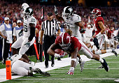 Derrick Henry of the Alabama Crimson Tide dives for a touchdown in the fourth quarter against the Michigan State Spartans during the Goodyear Cotton...
