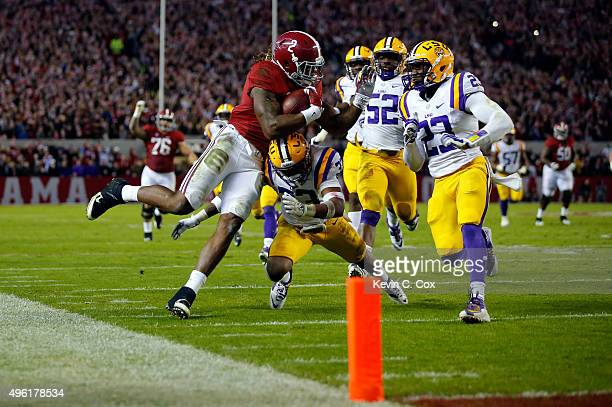 Derrick Henry of the Alabama Crimson Tide is tackled by Jamal Adams of the LSU Tigers in the second quarter at BryantDenny Stadium on November 7 2015...