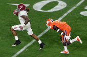Derrick Henry of the Alabama Crimson Tide runs foe a 50 yard touchdown in the first quarter against Jayron Kearse of the Clemson Tigers during the...