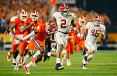 Derrick Henry of the Alabama Crimson Tide runs for a 50 yard touchdown in the first quarter against Jayron Kearse of the Clemson Tigers during the...