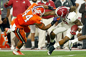 Derrick Henry of the Alabama Crimson Tide runs the ball in the second quarter against BJ Goodson of the Clemson Tigers during the 2016 College...