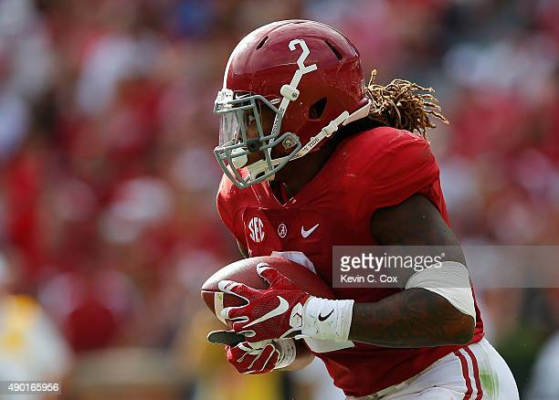 Derrick Henry of the Alabama Crimson Tide rushes against the Louisiana Monroe Warhawks at BryantDenny Stadium on September 26 2015 in Tuscaloosa...