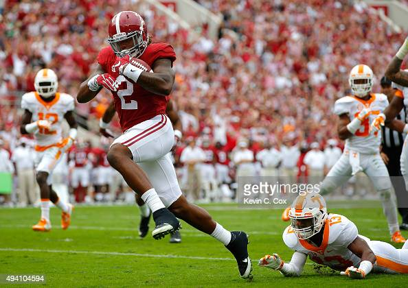 Derrick Henry of the Alabama Crimson Tide rushes in for a touchdown as a breaks a tackle by Malik Foreman of the Tennessee Volunteers at BryantDenny...