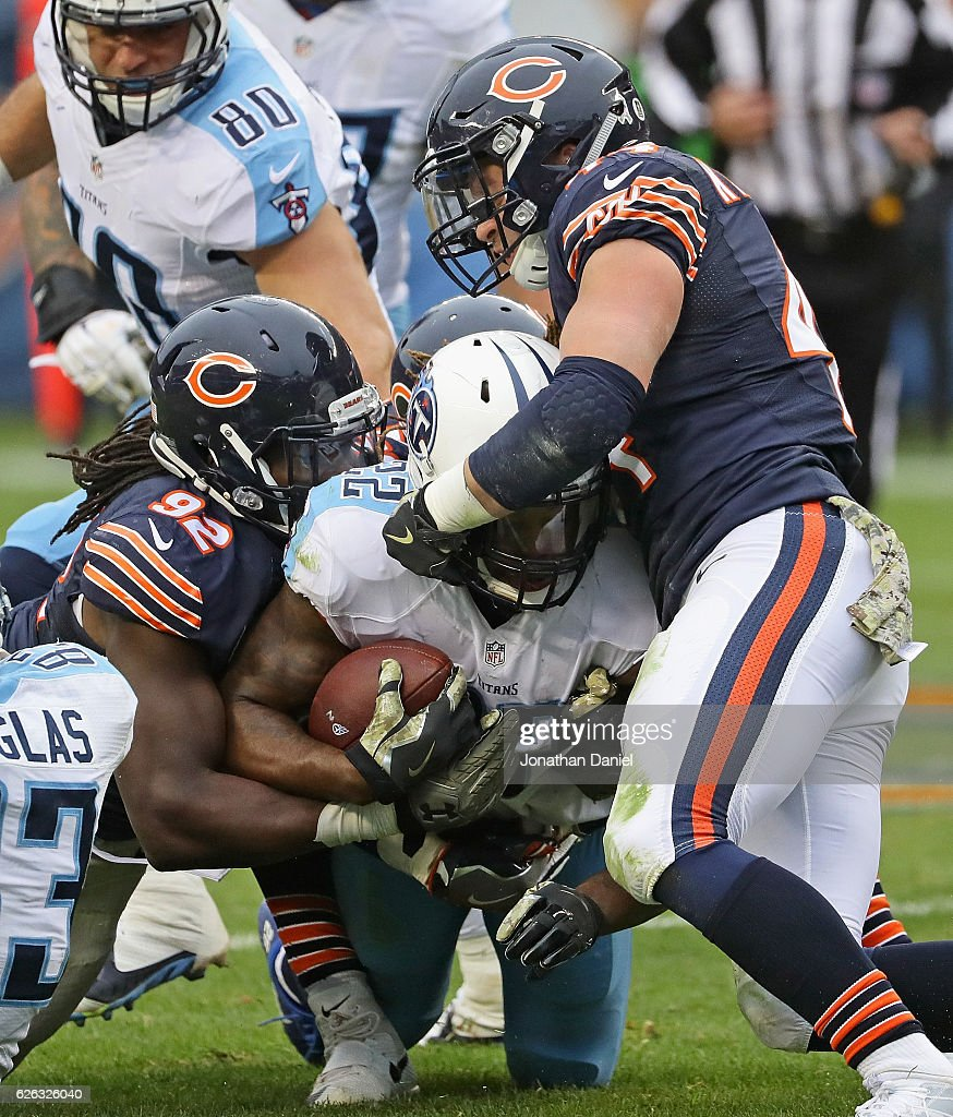 Derrick Henry #22 of the Tennessee Titans is dropped by Pernell McPhee #92 and Nick Kwiatkoski #44 of the Chicago Bears at Soldier Field on November 27, 2016 in Chicago, Illinois. The Titans defeated the Bears 27-21.