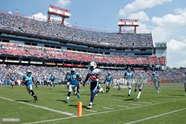 Derrick Henry of the Tennessee Titans runs for a 17yard touchdown in the first quarter of a preseason game against the Carolina Panthers at Nissan...