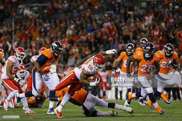 Derrick Johnson of the Kansas City Chiefs is tackled by Peyton Manning of the Denver Broncos after recovering a fumble in the first quarter at Sports...