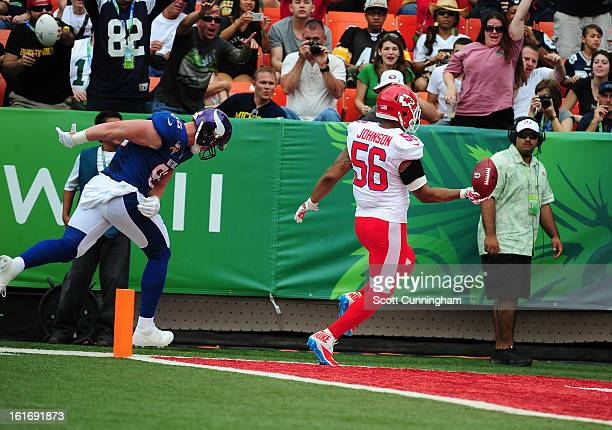 Derrick Johnson of the Kansas City Chiefs returns an interception for a touchdown against the National Football Conference team during the 2013 Pro...