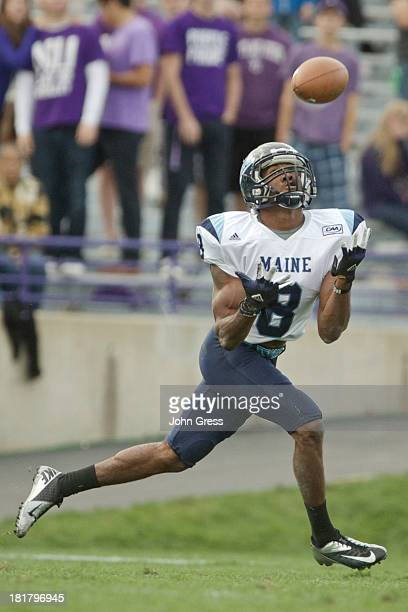 Derrick Johnson of the Maine Black Bears catches the ball while playing the Northwestern Wildcats during the second quarter of their college football...