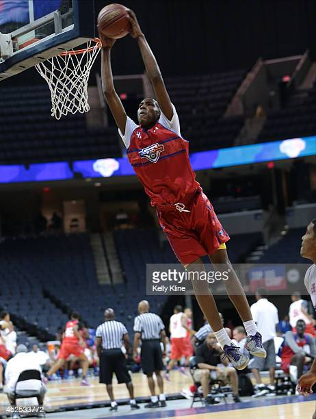 Derrick Jones in red glides in for the dunk during the National Basketball Players Association Top 100 Camp on June 17 2014 at John Paul Jones Arena...
