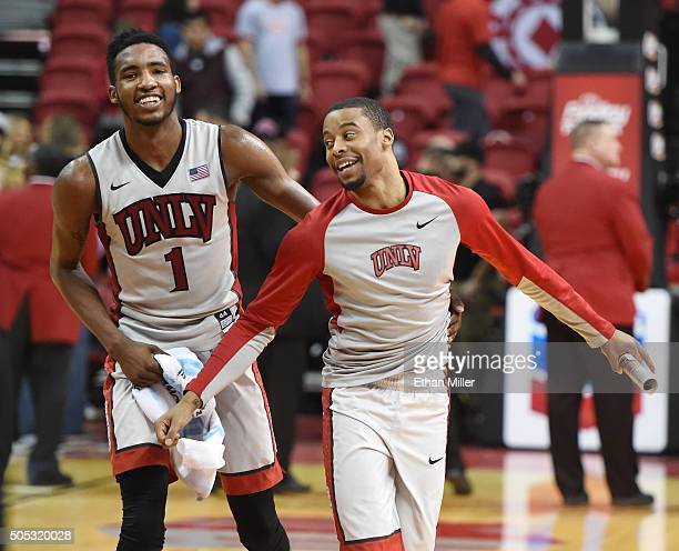 Derrick Jones Jr #1 and Jerome Seagears of the UNLV Rebels celebrate on the court after their 10064 win over the Air Force Falcons at the Thomas Mack...