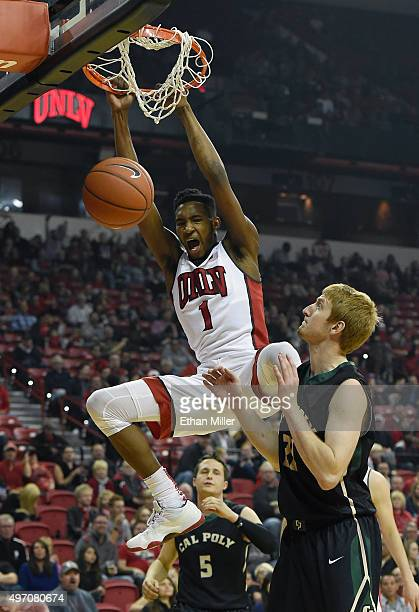 Derrick Jones Jr #1 of the UNLV Rebels dunks against Luke Meikle of the Cal Poly Mustangs during their game at the Thomas Mack Center on November 13...