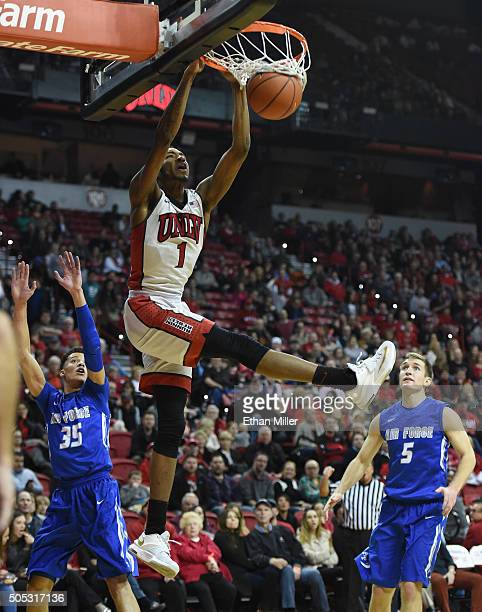 Derrick Jones Jr #1 of the UNLV Rebels dunks in front of Hayden Graham and Zach Kocur of the Air Force Falcons during their game at the Thomas Mack...