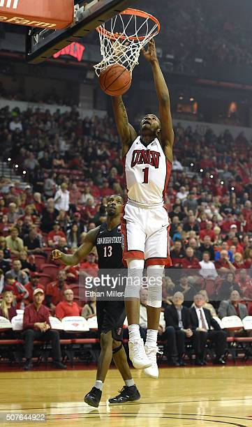 Derrick Jones Jr #1 of the UNLV Rebels dunks in front of Winston Shepard of the San Diego State Aztecs during their game at the Thomas Mack Center on...