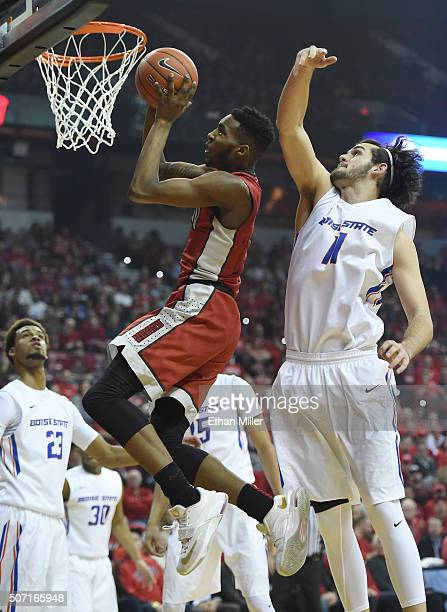 Derrick Jones Jr #1 of the UNLV Rebels is fouled as he drives to the basket by Zach Haney of the Boise State Broncos during their game at the Thomas...