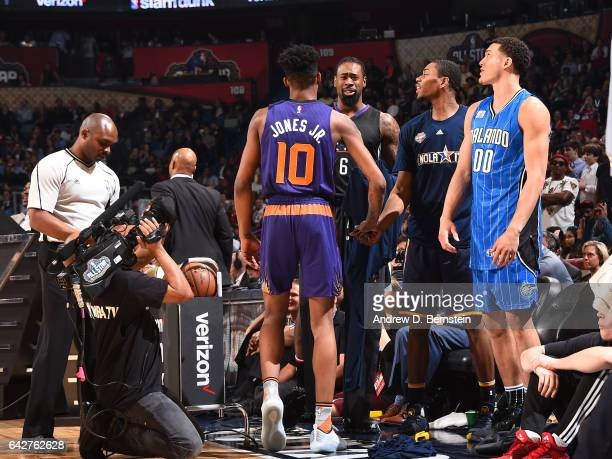 Derrick Jones Jr #10 of the Phoenix Suns celebrates with the bench during the Verizon Slam Dunk Contest during State Farm AllStar Saturday Night as...