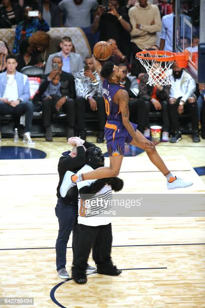Derrick Jones Jr #10 of the Phoenix Suns dunks the ball during the Verizon Slam Dunk Contest during State Farm AllStar Saturday Night as part of the...