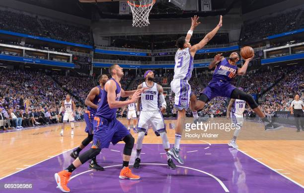 Derrick Jones Jr #10 of the Phoenix Suns goes up for the shot against Skal Labissiere of the Sacramento Kings on April 11 2017 at Golden 1 Center in...