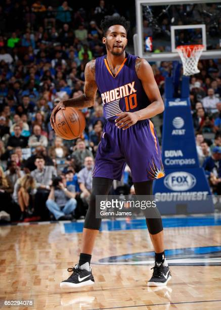 Derrick Jones Jr #10 of the Phoenix Suns handles the ball against the Dallas Mavericks during the game on March 11 2017 at the American Airlines...
