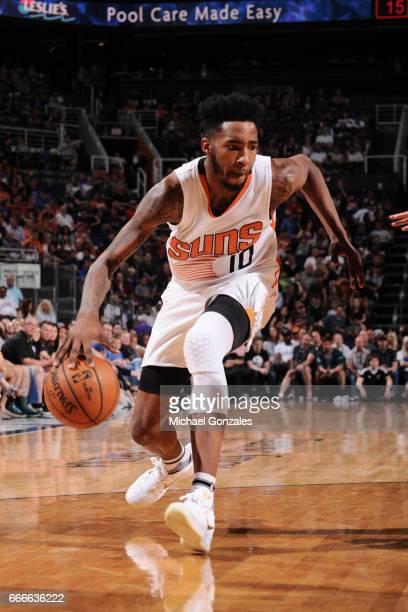 Derrick Jones Jr #10 of the Phoenix Suns handles the ball against the Dallas Mavericks on April 9 2017 at Talking Stick Resort Arena in Phoenix...