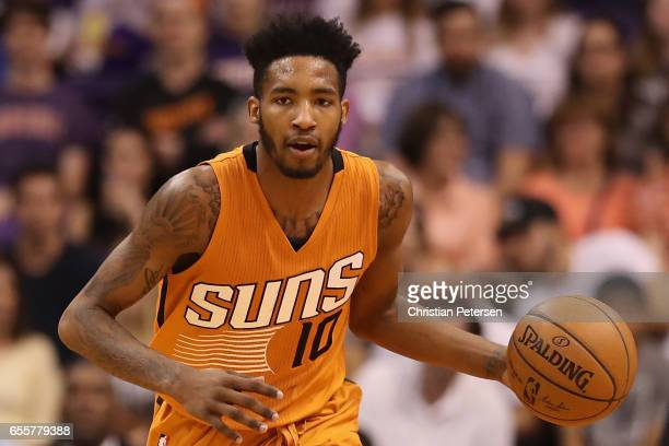 Derrick Jones Jr #10 of the Phoenix Suns handles the ball during the first half of the NBA game against the Portland Trail Blazers at Talking Stick...