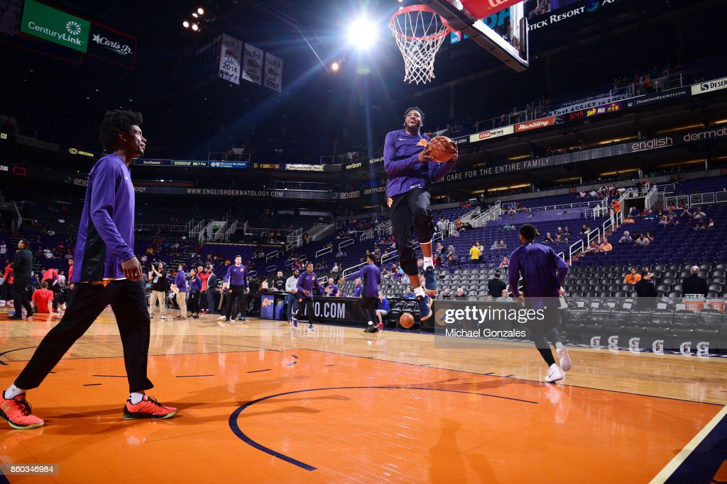 Derrick Jones Jr. #10 of the Phoenix Suns warms up before the preseason game against the Portland Trail Blazers on October 11, 2017 at Talking Stick Resort Arena in Phoenix, Arizona.