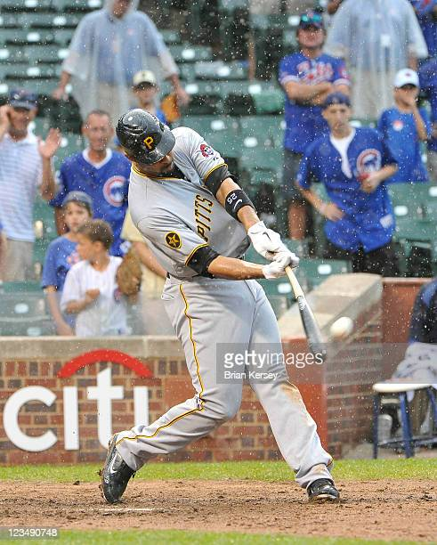 Derrick Lee of the Pittsburgh Pirates connects on a grand slam scoring teammates Xavier Paul Jose Tabata and Andrew McCutchen during the ninth inning...