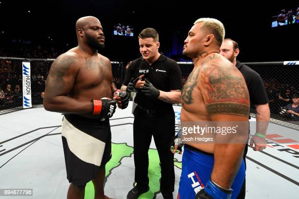 Derrick Lewis and Mark Hunt of New Zealand touch gloves before their heavyweight fight during the UFC Fight Night event at the Spark Arena on June 11...