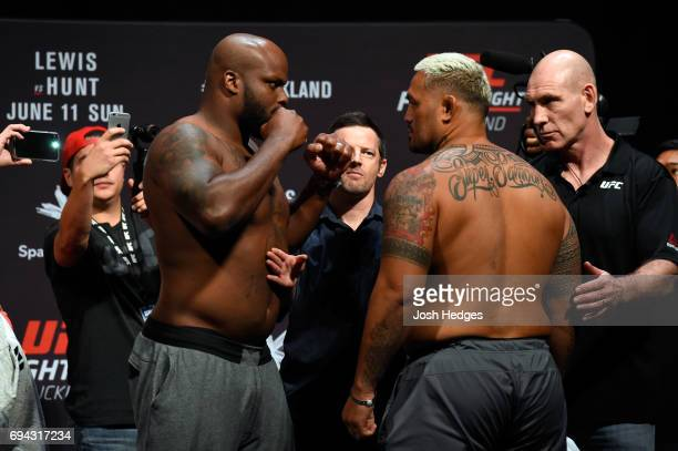 Derrick Lewis of the United States and Mark Hunt of New Zealand face off during the UFC Fight Night weighin at Spark Arena on June 10 2017 in...