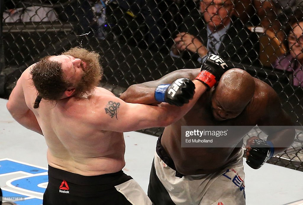 Derrick Lewis punches Roy Nelson in their heavyweight bout during the UFC Fight Night event inside the MGM Grand Garden Arena on July 7, 2016 in Las Vegas, Nevada.