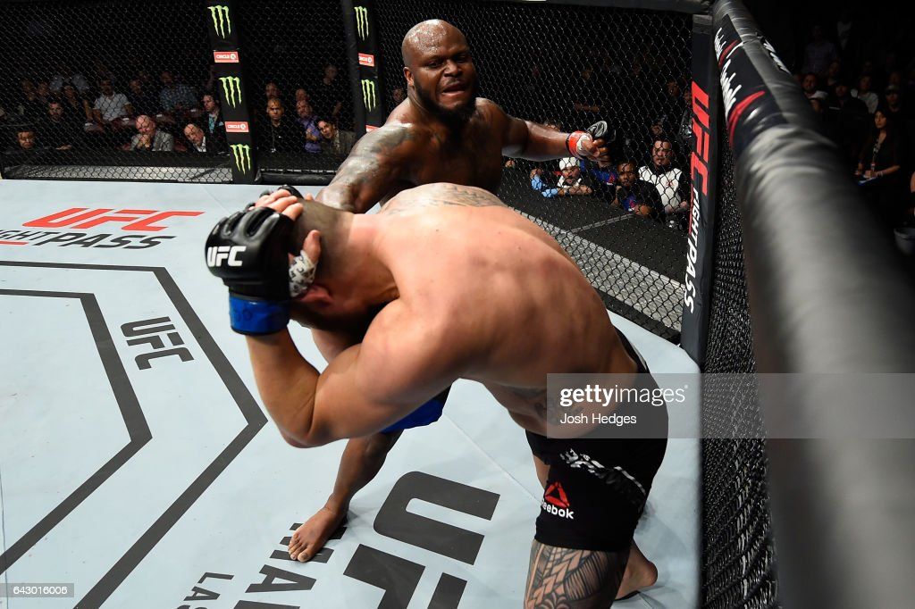 Derrick Lewis (top) punches Travis Browne in their heavyweight fight during the UFC Fight Night event inside the Scotiabank Centre on February 19, 2017 in Halifax, Nova Scotia, Canada.