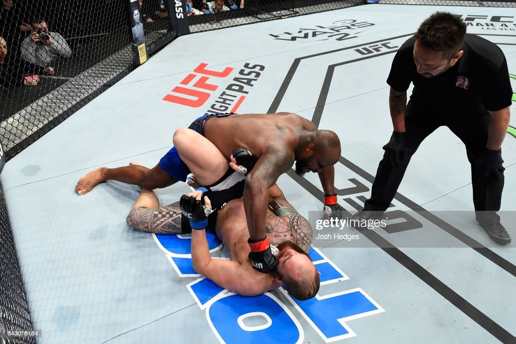 Derrick Lewis punches Travis Browne in their heavyweight fight during the UFC Fight Night event inside the Scotiabank Centre on February 19, 2017 in Halifax, Nova Scotia, Canada.