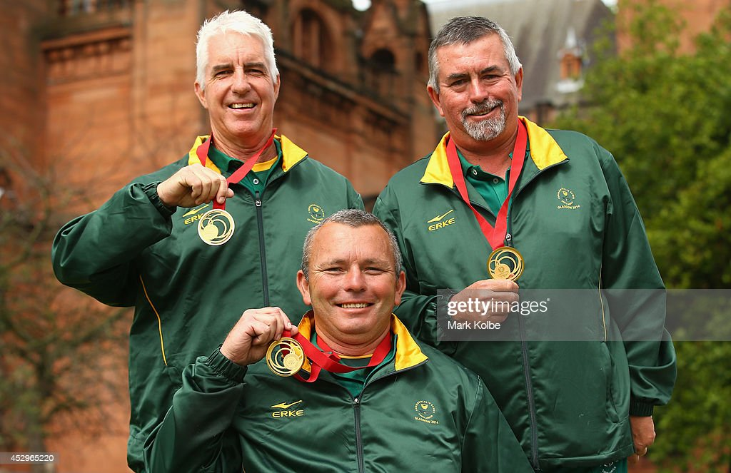 Derrick Lobban, Deon van de Vyver and Roger Hagerty of South Africa pose with their gold medals won in the Para-Sport Open Triples B6/B7/B8 lawn bowls at Kelvingrove Lawn Bowls Centre during day eight of the Glasgow 2014 Commonwealth Games on July 31, 2014 in Glasgow, United Kingdom.