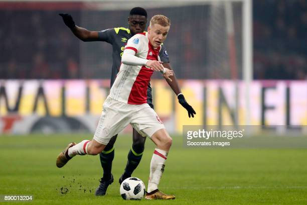Derrick Luckassen of PSV Donny van de Beek of Ajax during the Dutch Eredivisie match between Ajax v PSV at the Johan Cruijff Arena on December 10...