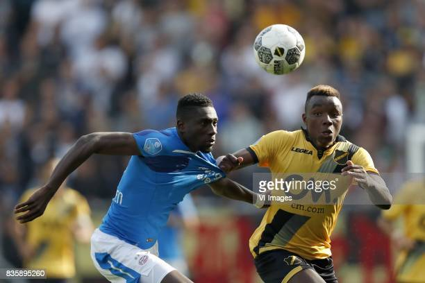 Derrick Luckassen of PSV Thierry Ambrose of NAC Breda during the Dutch Eredivisie match between NAC Breda and PSV Eindhoven at the Rat Verlegh...