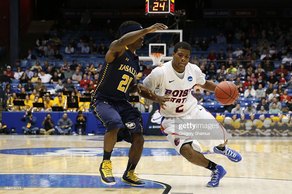 Derrick Marks #2 of the Boise State Broncos drives against Tyrone Garland #21 of the La Salle Explorers in the second half during the first round of the 2013 NCAA Men's Basketball Tournament at University of Dayton Arena on March 20, 2013 in Dayton, Ohio.