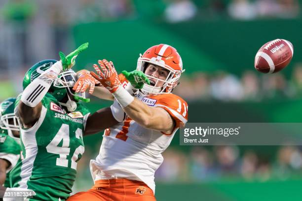 Derrick Moncrief of the Saskatchewan Roughriders breaks up a pass intended for Danny Vandervoort of the BC Lions in the game between the BC Lions and...