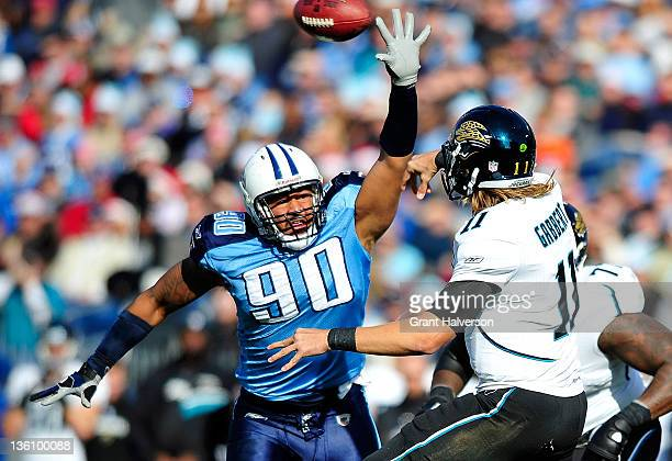 Derrick Morgan of the Tennessee Titans pressures a pass by Blaine Gabbert of the Jacksonville Jaguars during play at LP Field on December 24 2011 in...
