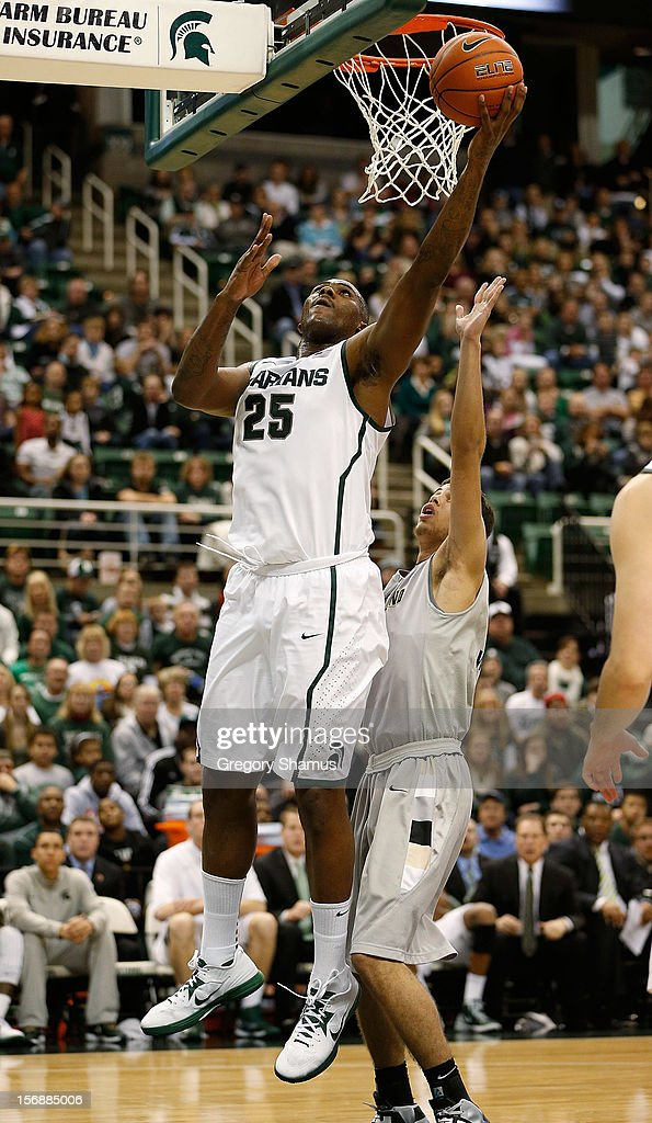 Derrick Nix #25 of the Michigan State Spartans gets to the basket for a second half basket past Dante Williams #2 of the Oakland Golden Grizzlies at the Jack T. Breslin Students Events Center on November 23, 2012 in East Lansing, Michigan. Michigan State won the game 70-52.