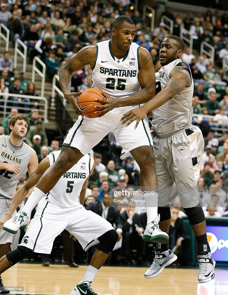 Derrick Nix #25 of the Michigan State Spartans grabs a first half rebound next to Lloyd Neely II #12 of the Oakland Golden Grizzlies at the Jack T. Breslin Students Events Center on November 23, 2012 in East Lansing, Michigan.