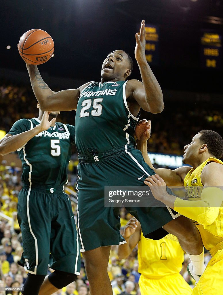 Derrick Nix #25 of the Michigan State Spartans grabs a first half rebound in front of Jordan Morgan #52 of the Michigan Wolverines at Crisler Center on March 3, 2013 in Ann Arbor, Michigan.