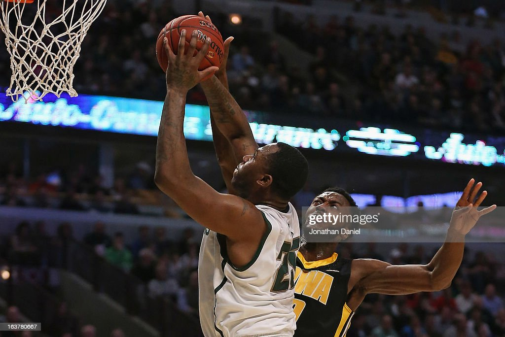 Derrick Nix #25 of the Michigan State Spartans shoots against Gabriel Olaseni #0 of the Iowa Hawkeyes during a quarterfinal game of the Big Ten Basketball Tournament at the United Center on March 15, 2013 in Chicago, Illinois.