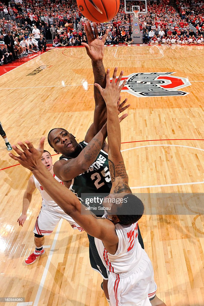Derrick Nix #25 of the Michigan State Spartans shoots over Amir Williams #23 of the Ohio State Buckeyes in the first half on February 24, 2013 at Value City Arena in Columbus, Ohio. Ohio State defeated Michigan State 68-60.