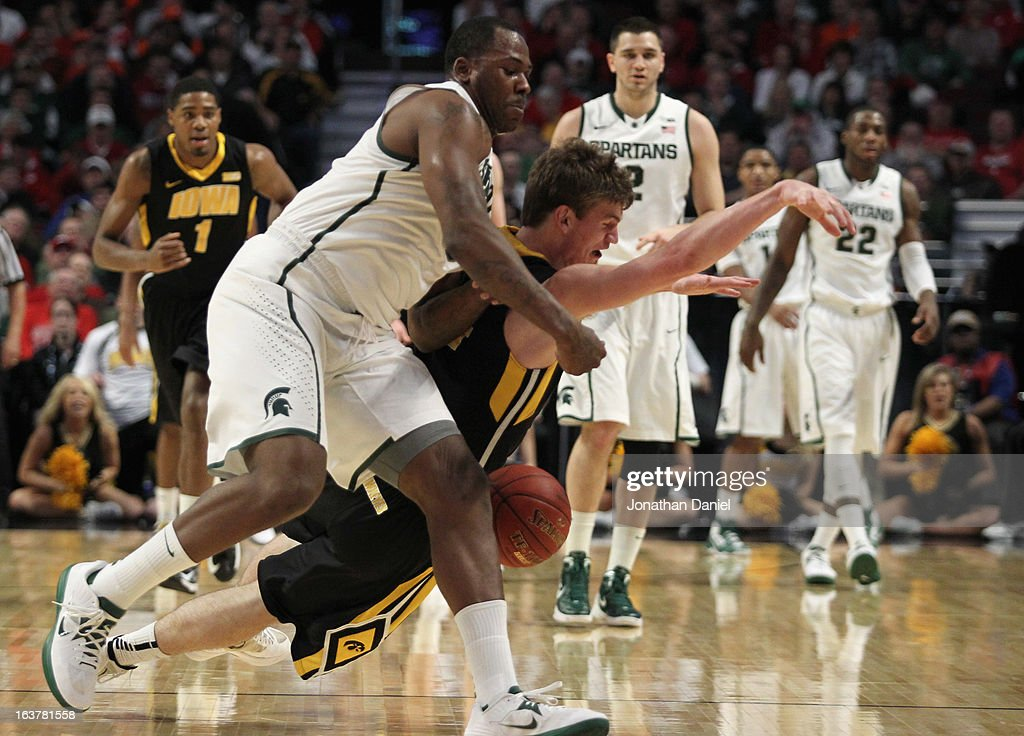 Derrick Nix #25 of the Michigan State Spartans slams into Adam Woodbury #34 of the Iowa Hawkeyes during a quarterfinal game of the Big Ten Basketball Tournament at the United Center on March 15, 2013 in Chicago, Illinois.