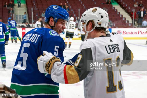 Derrick Pouliot of the Vancouver Canucks talks with Brendan Leipsic of the Vegas Golden Knights during warmup before their NHL game at Rogers Arena...