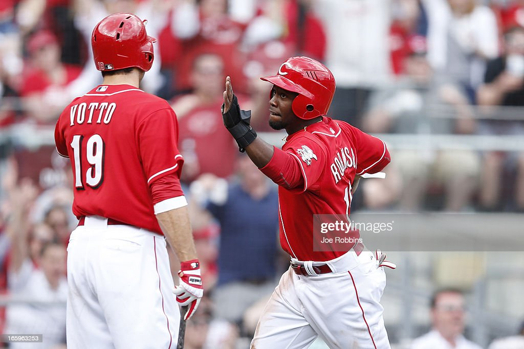 Derrick Robinson #15 and <a gi-track='captionPersonalityLinkClicked' href=/galleries/search?phrase=Joey+Votto&family=editorial&specificpeople=759319 ng-click='$event.stopPropagation()'>Joey Votto</a> #19 of the Cincinnati Reds celebrate after Robinson scored the go-ahead run in the sixth inning of the game against the Washington Nationals at Great American Ball Park on April 7, 2013 in Cincinnati, Ohio. The Reds won 6-3.