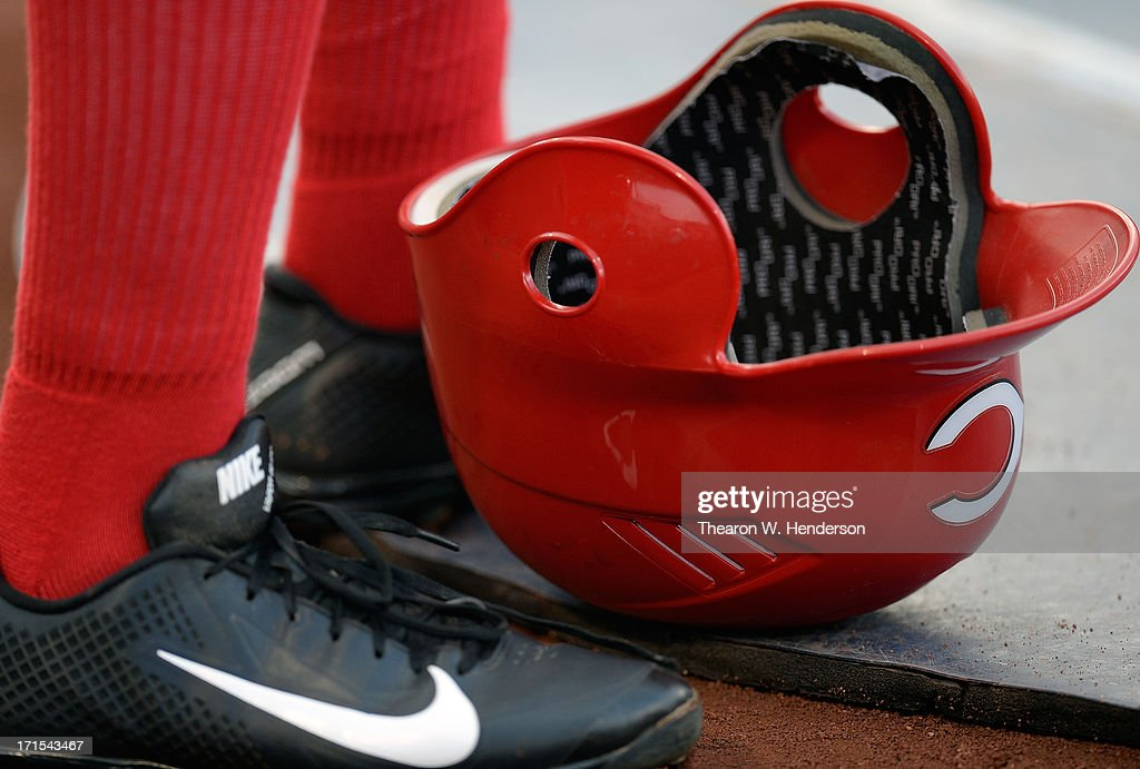 Derrick Robinson #15 of the Cincinnati Reds wearing Nike Baseball cleats stands next to his batting helmet in the on-deck circle against the Oakland Athletics at O.co Coliseum on June 25, 2013 in Oakland, California.